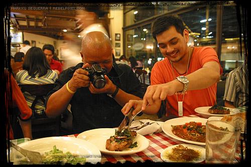 Abe and Jayvee sharing steak. How sweet!