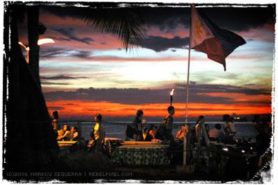Baywalk. Flag. Sunset.